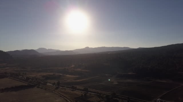 wide aerial, sun shines over rural landscape in mexico - wide stock-videos und b-roll-filmmaterial