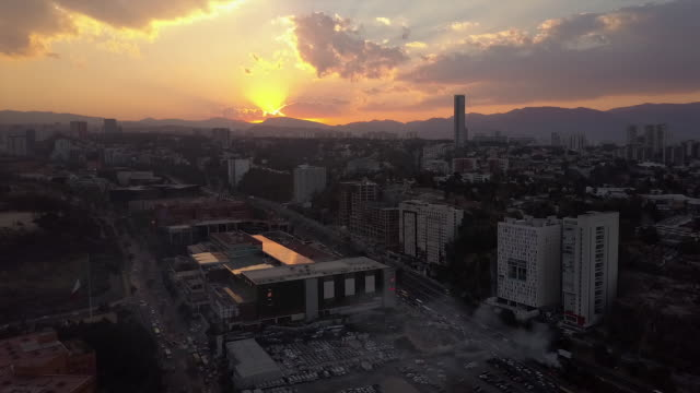 Wide aerial, sunset over Mexico City skyline