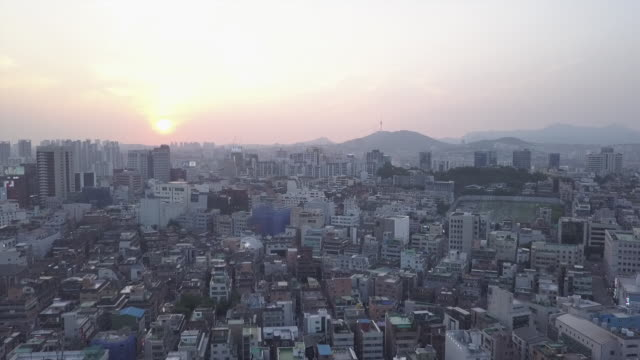 wide aerial, sunset over south korea city - korea stock-videos und b-roll-filmmaterial
