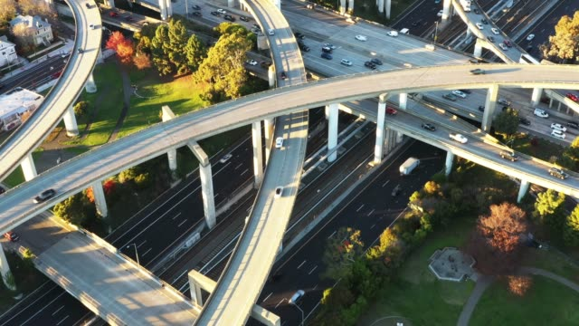 wide aerial, traffic on freeway overpasses - oakland california stock videos & royalty-free footage