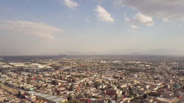 Wide aerial, vast Mexico cityscape
