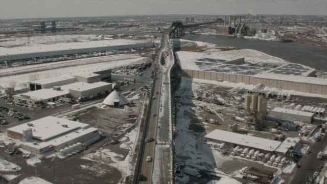 Wide Aerial View Following Highway In Jersey City Towards Bridge