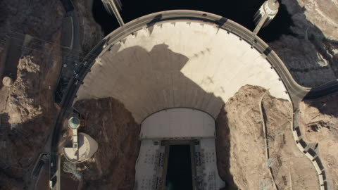 wide aerial view looking down of the hoover dam - nevada stock videos & royalty-free footage