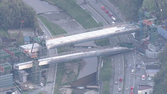Wide aerial view of a bridge under construction as part of the ShinMeishin Expressway fallen onto National Route 176 around 430pm on 22nd April 2016...