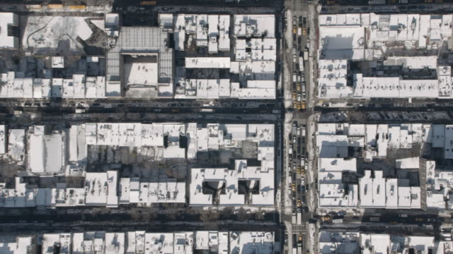 Wide Aerial View Of A Snowy Greenwich Village On A Sunny Winter Day