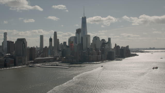 Wide Aerial View Of Downtown Manhattan And Freedom Tower From The Hudson River On A Sunny Winter Day