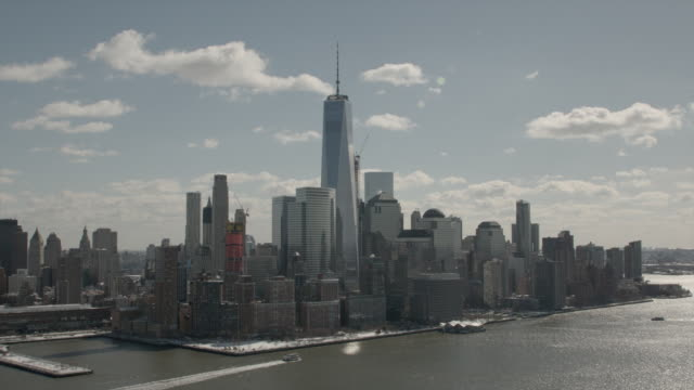 Wide Aerial View Of Downtown Manhattan and Freedom Tower On A Sunny Winter Day
