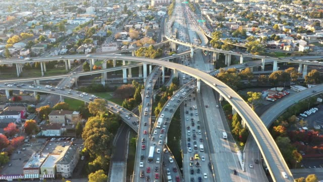 wide aerial, view of freeways during rush hour - oakland california stock videos & royalty-free footage