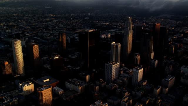 vídeos y material grabado en eventos de stock de wide aerial view of los angeles, downtown skyscrapers in foreground. shot in october 2010. - artbeats