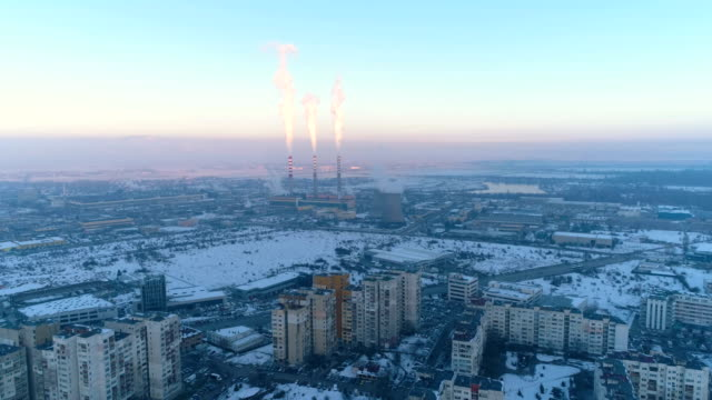 wide aerial view of smoking power plant chimneys during sunset - pipeline stock videos and b-roll footage