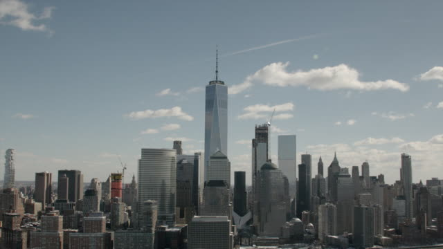 Wide Aerial View Of The Freedom Tower And Downtown Manhattan On A Sunny Day.