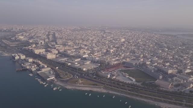 wide aerial view of the island of muharraq. - ペルシャ湾点の映像素材/bロール