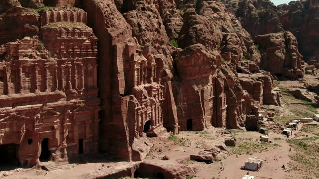 wide aerial views of ancient petra, jordan - rock face stock videos & royalty-free footage