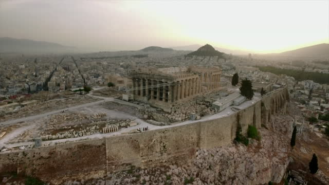 wide aerial zooming into parthenon, athens - temple building stock videos & royalty-free footage