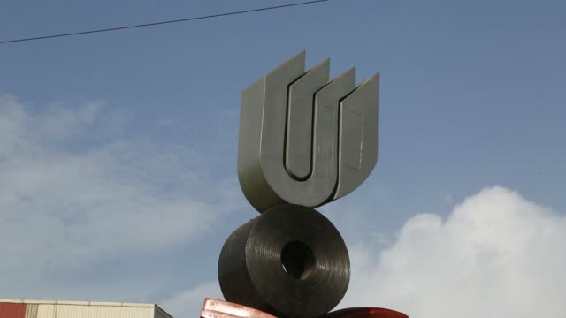 wide and medium shot of the logo of uttam galva steels ltd the indian unit of arcelormittal is displayed atop a sculpture at the companys... - steel stock videos & royalty-free footage