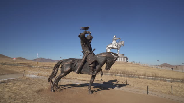 wide angle: a giant bronze statue of a warrior holding a hawk in mongolia - ulaanbaatar, mongolia - ulan bator stock videos & royalty-free footage