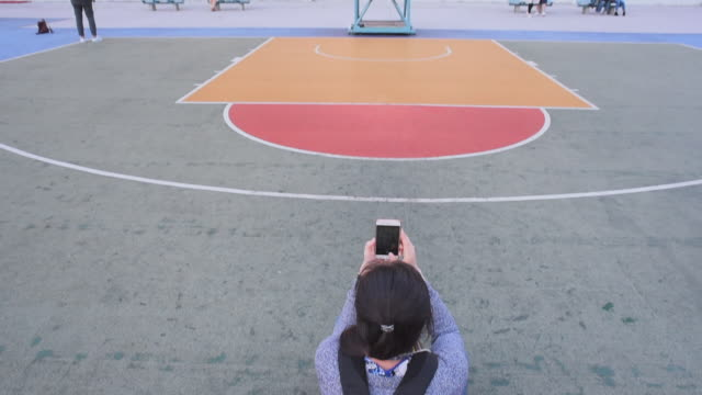 wide angle: a kid tries to make a basketball shot - breit stock-videos und b-roll-filmmaterial