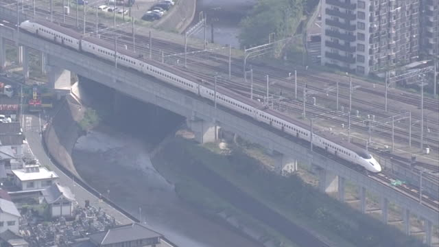 wide angle aerial view of a derailed kyushu shinkansen bullet train stopped near kumamoto station after consecutive earthquake hits during 2016... - kyushu shinkansen stock videos & royalty-free footage