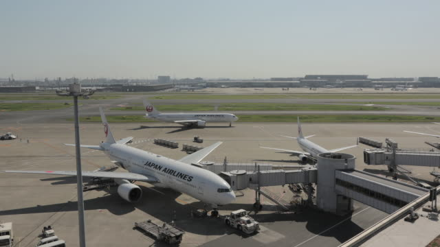 Wide angle all day time lapse of the airport apron captured from the observation deck in Haneda airport