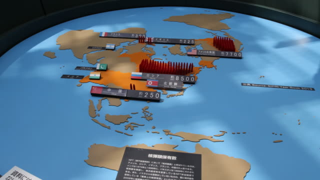 vidéos et rushes de wide angle at the atomic bomb museum nagasaki a installation displaying which and how much nuclear weapons are owned by countries in the world - arme de destruction massive