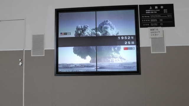 wide angle at the atomic bomb museum nagasaki a video installation displays several videos of nuclear tests from variant nations - 大量破壊兵器点の映像素材/bロール