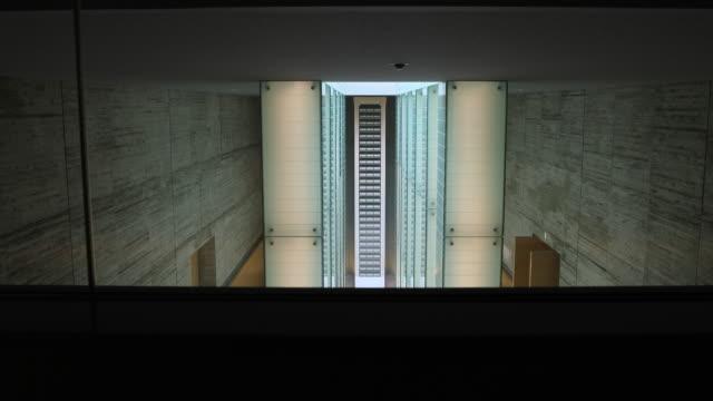 wide angle at the atomic bomb museum nagasaki view from above at the national peace memorial hall for the atomic bomb victims - massförstörelsevapen bildbanksvideor och videomaterial från bakom kulisserna
