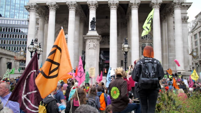 wide angle corn exchange extinction rebellion protest london 2020 out side the bank of england with drummers and colourful flags - campaigner stock videos & royalty-free footage
