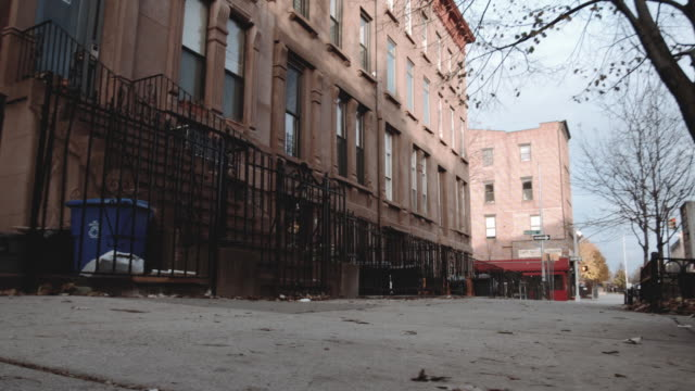 wide angle dolly shot of a quiet block in brooklyn - abandoned stock videos & royalty-free footage