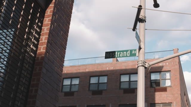wide angle establishing shot of iconic nostrand avenue in bedford stuyvesant, brooklyn. - pole stock videos & royalty-free footage