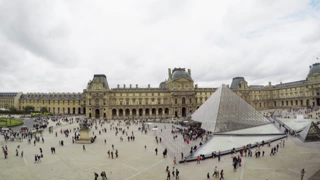 wide angle exterior of the louvre museum - louvre stock videos and b-roll footage