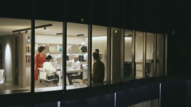 Wide Angle Exterior video of Meeting of Design Professionals in Office Late at Night