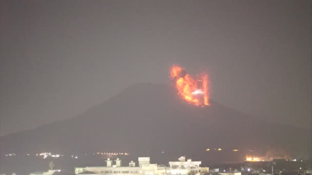 Wide angle fixed view of the moment of a dramatic eruption of Mount Sakurajima caught on camera The volcano violently spewing red lava straight up in...