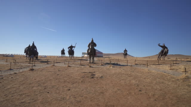 wide angle: group of giant bronze statues of warriors in genghis khan equestrian complex - ulaanbaatar, mongolia - cavalry stock videos & royalty-free footage