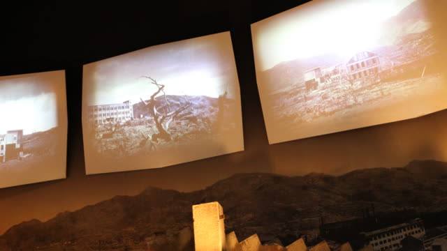 wide angle inside the atomic bomb museum nagasaki historic photographs that illustrate the history of the disaster are illuminated as part of a... - 大量破壊兵器点の映像素材/bロール