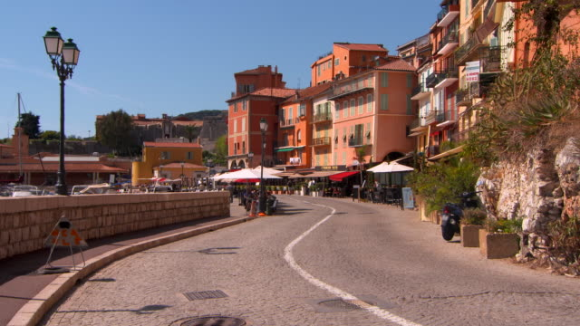 wide angle: narrow street in a small town - cote d'azur stock videos & royalty-free footage