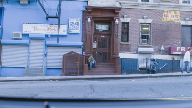 wide angle of apartment building stoop and city street. brick buidlings. - front stoop stock videos and b-roll footage