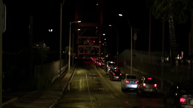 wide angle of cars in traffic at andrew mcardle, meridian st. bridge. drawbridge. - drawbridge stock videos and b-roll footage