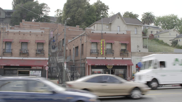 wide angle of chinese restaurant, two story brick building. could be echo park. sunset blvd. - kalifornien stock-videos und b-roll-filmmaterial