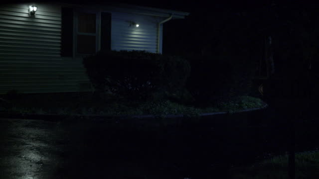 wide angle of driveway in front of house or motel building. street sign.
