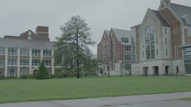 wide angle of multi-story brick buildings. could be college campus.