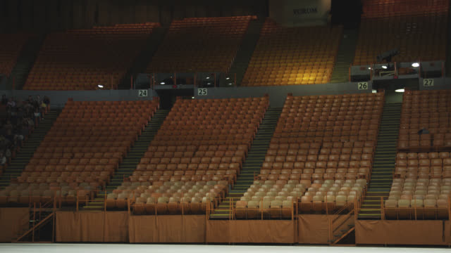 wide angle of stadium, auditorium, or concert venue. empty seats visible. the forum. people visible in seats.  people stand and clap. - concert hall stock videos and b-roll footage