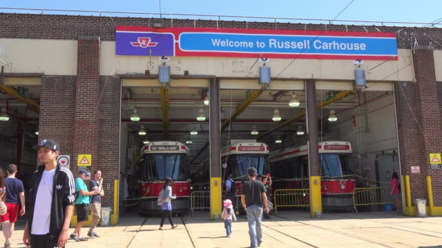 stockvideo's en b-roll-footage met wide angle of the installations keeping the aging fleet of current streetcars the carhouse is accessible to the public during the 'open doors... - sociale geschiedenis