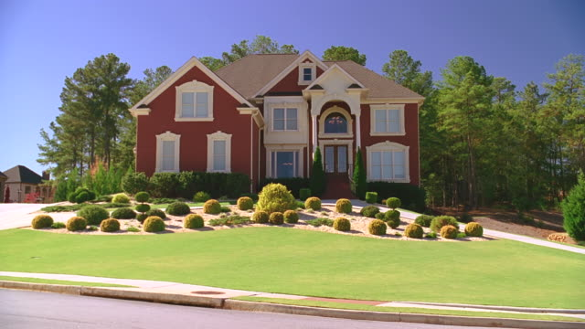 wide angle on nice red brick two-story house - establishing shot stock videos & royalty-free footage