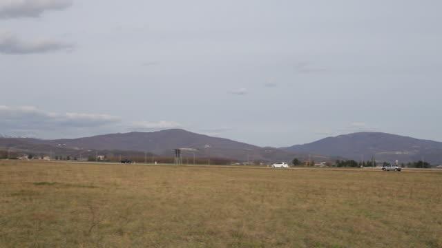 wide angle pan shot of matajur mountain, julian pre-alps - julian alps stock videos and b-roll footage