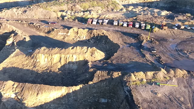 wide angle perspective, aerial view. the total devastation of open-pit coal mining is seen in the whole town of cloete. various immense craters... - destruction stock videos & royalty-free footage