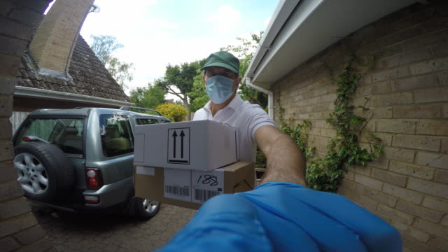 wide angle point of view shot of a delivery man arriving at a house.he rings the door bell and waits. - online shopping stock videos & royalty-free footage