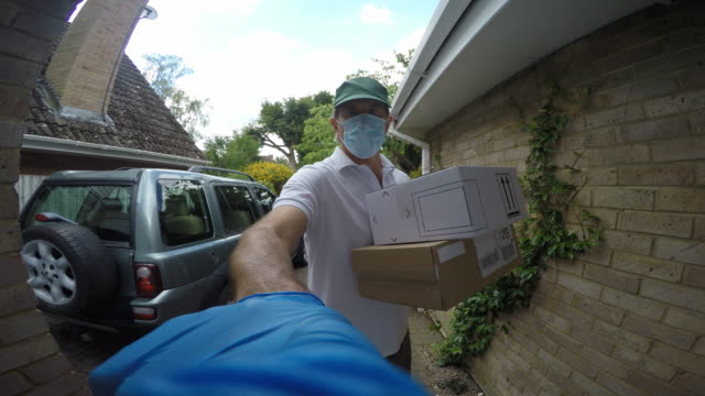 wide angle point of view shot of a delivery man arriving at a house.he rings the door bell and waits. - delivering stock videos & royalty-free footage
