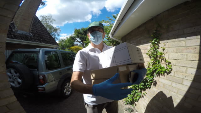 wide angle point of view shot of a delivery man arriving at a house.he rings the door bell and waits. - cardboard box stock videos & royalty-free footage