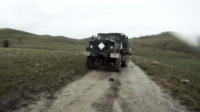 wide angle shot from the back of a convoy vehicle. - convoy stock videos and b-roll footage