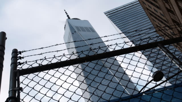 Wide angle shot looking up at New York City's Freedom Tower on a sunny afternoon